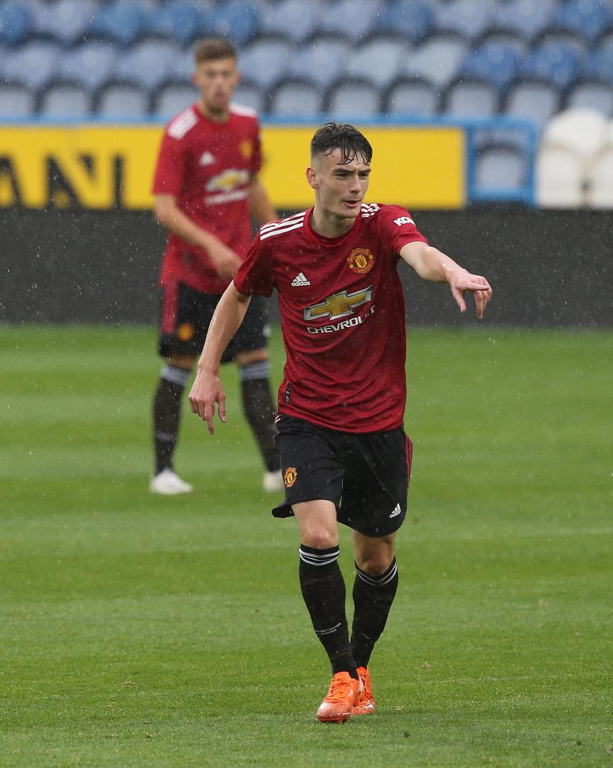 Mark Helm makes a point to a team-mate during Manchester United Under-23s' 3-3 draw at Huddersfield Town
