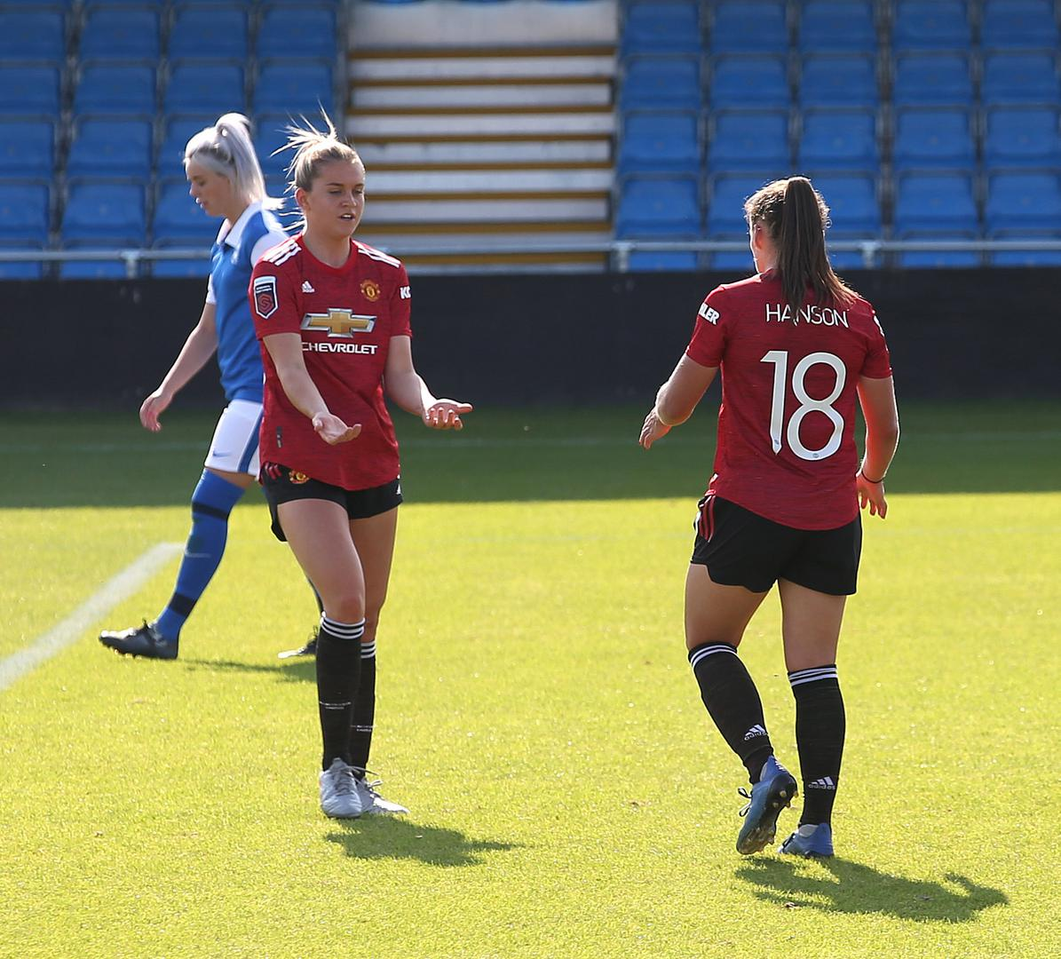 Alessia Russo celebrates a goal for Manchester United Women with team-mate Kirsty Hanson