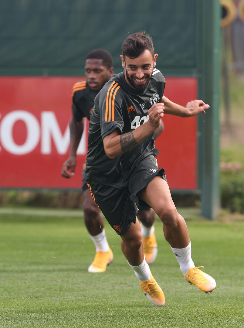 Bruno Fernandes smiles in a training session