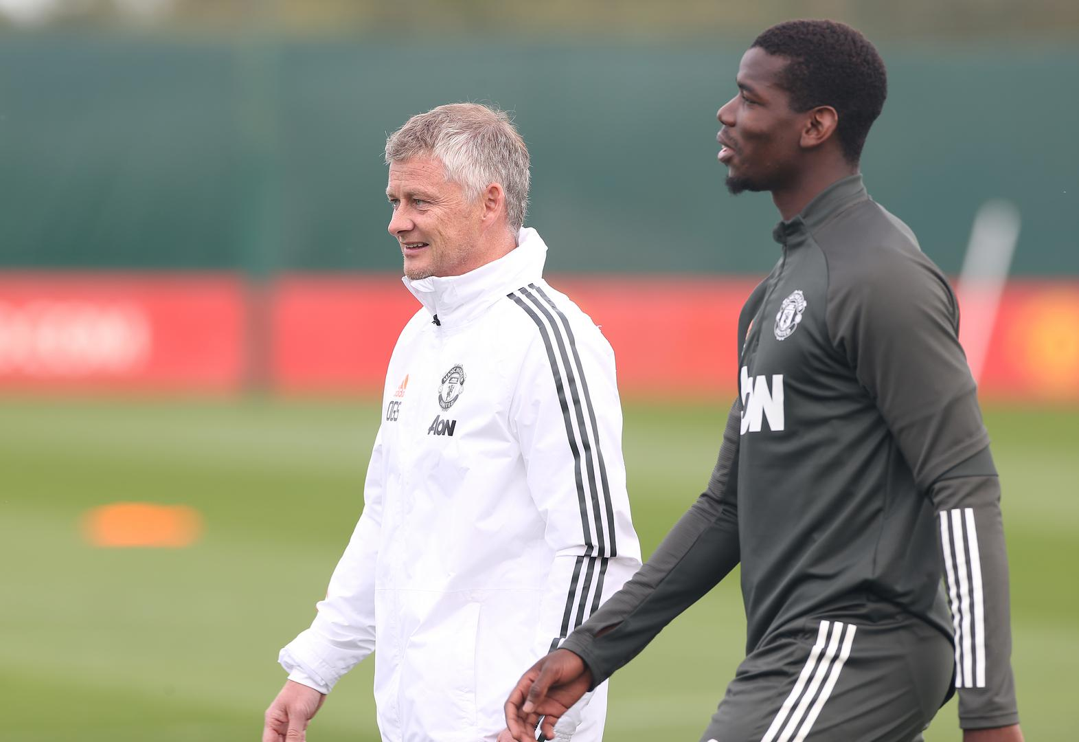 Solskjaer and Pogba during United training.