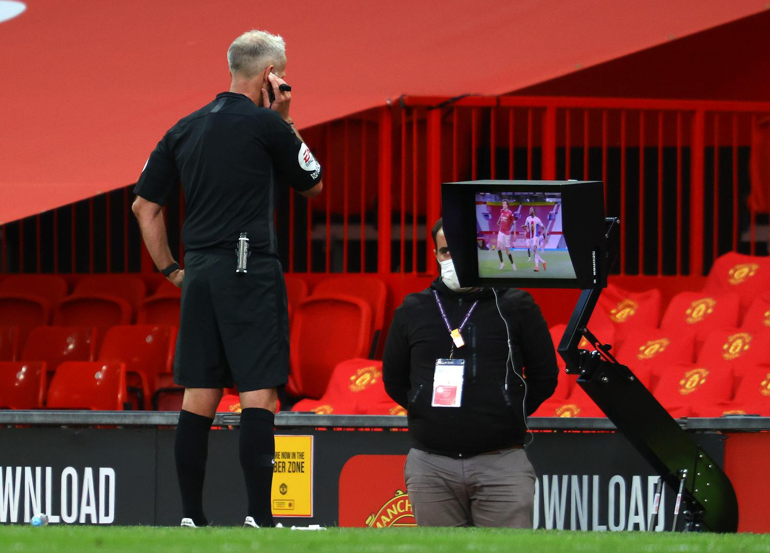 Martin Atkinson checking the VAR screen,