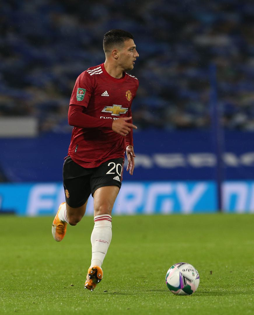 Diogo Dalot on the ball against Brighton & Hove Albion in the Carabao Cup.