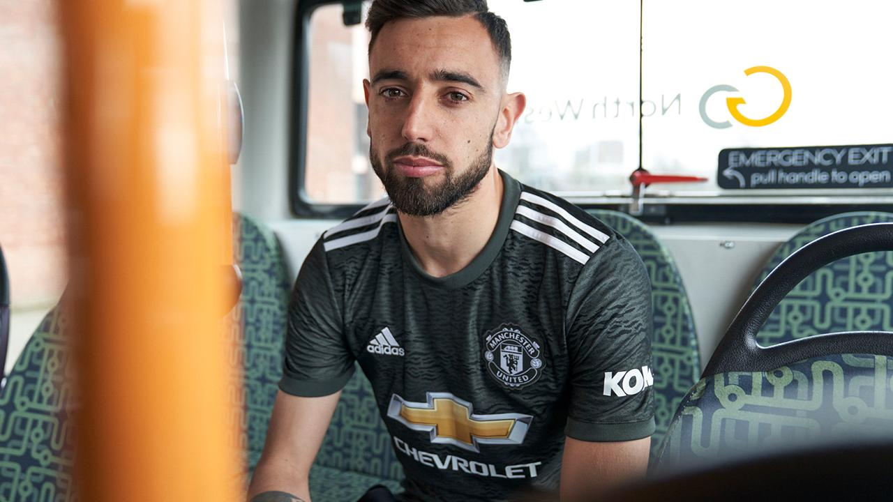 Bruno Fernandes models the 2020/21 Manchester United away shirt
