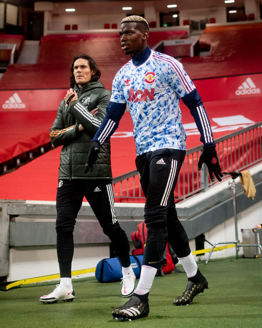 Edinson Cavani and Paul Pogba walk out for a Premier League game at Old Trafford