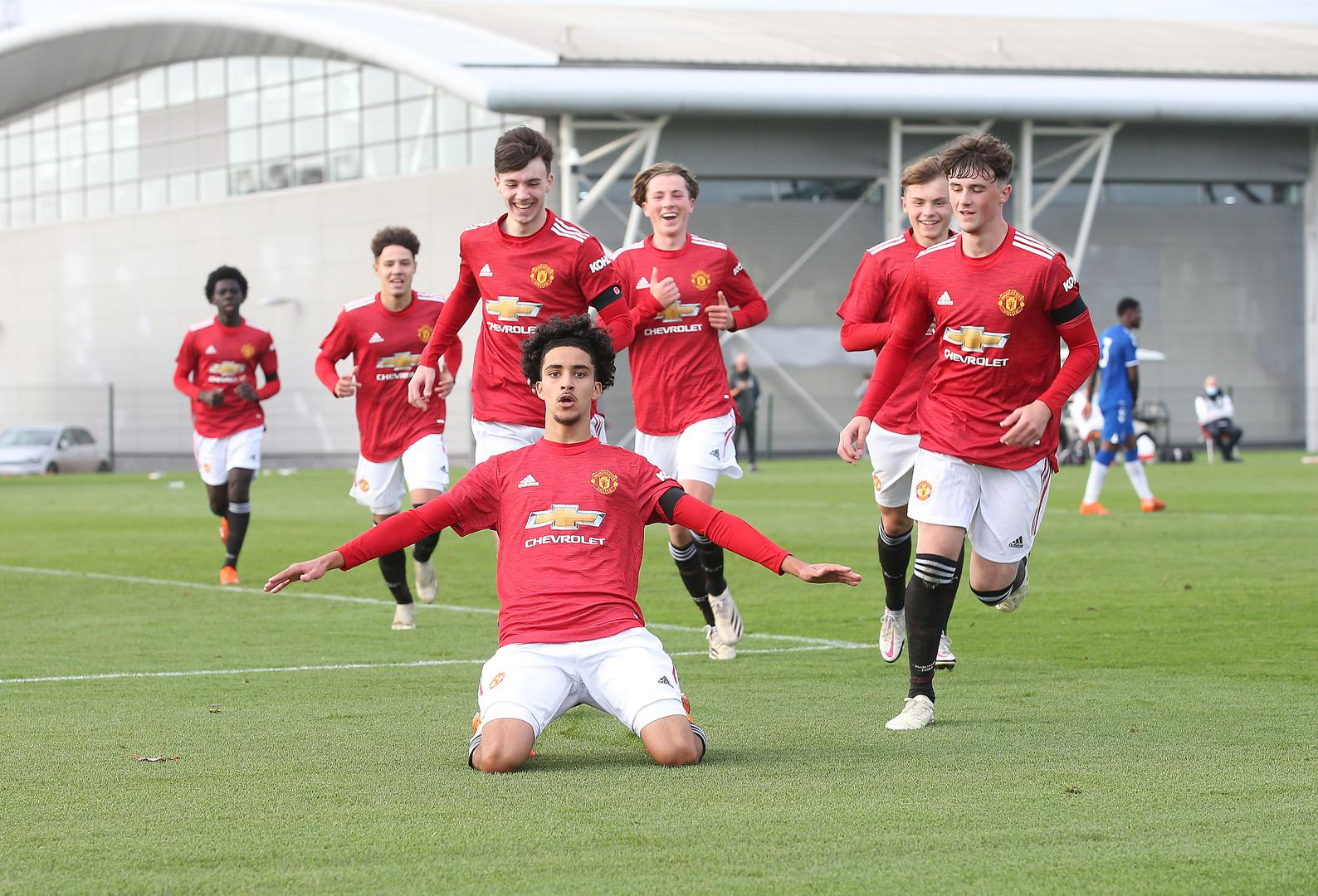 Zidane Iqbal celebrates with his team-mates after scoring for Manchester United Under-18s against Everton