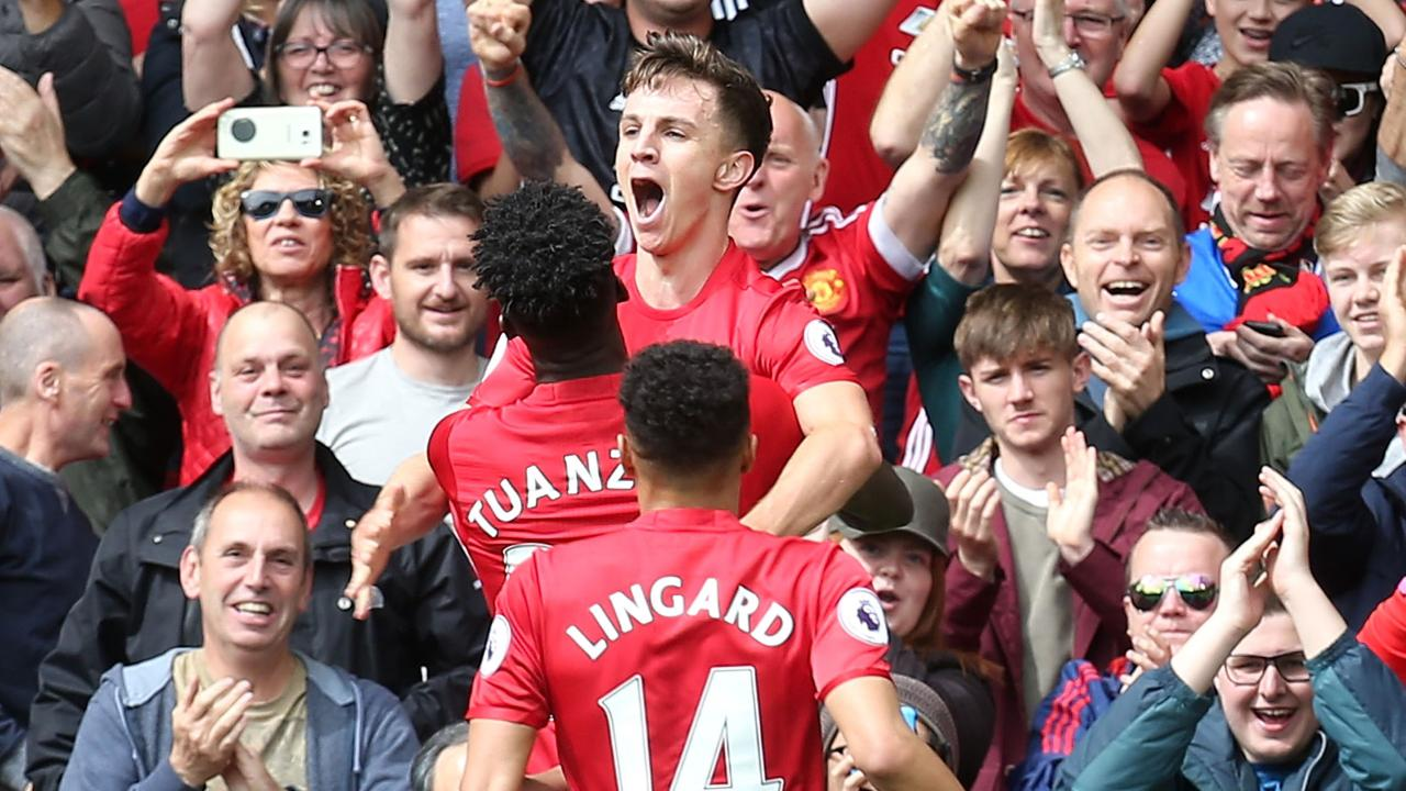 Josh Harrop celebrates for United.