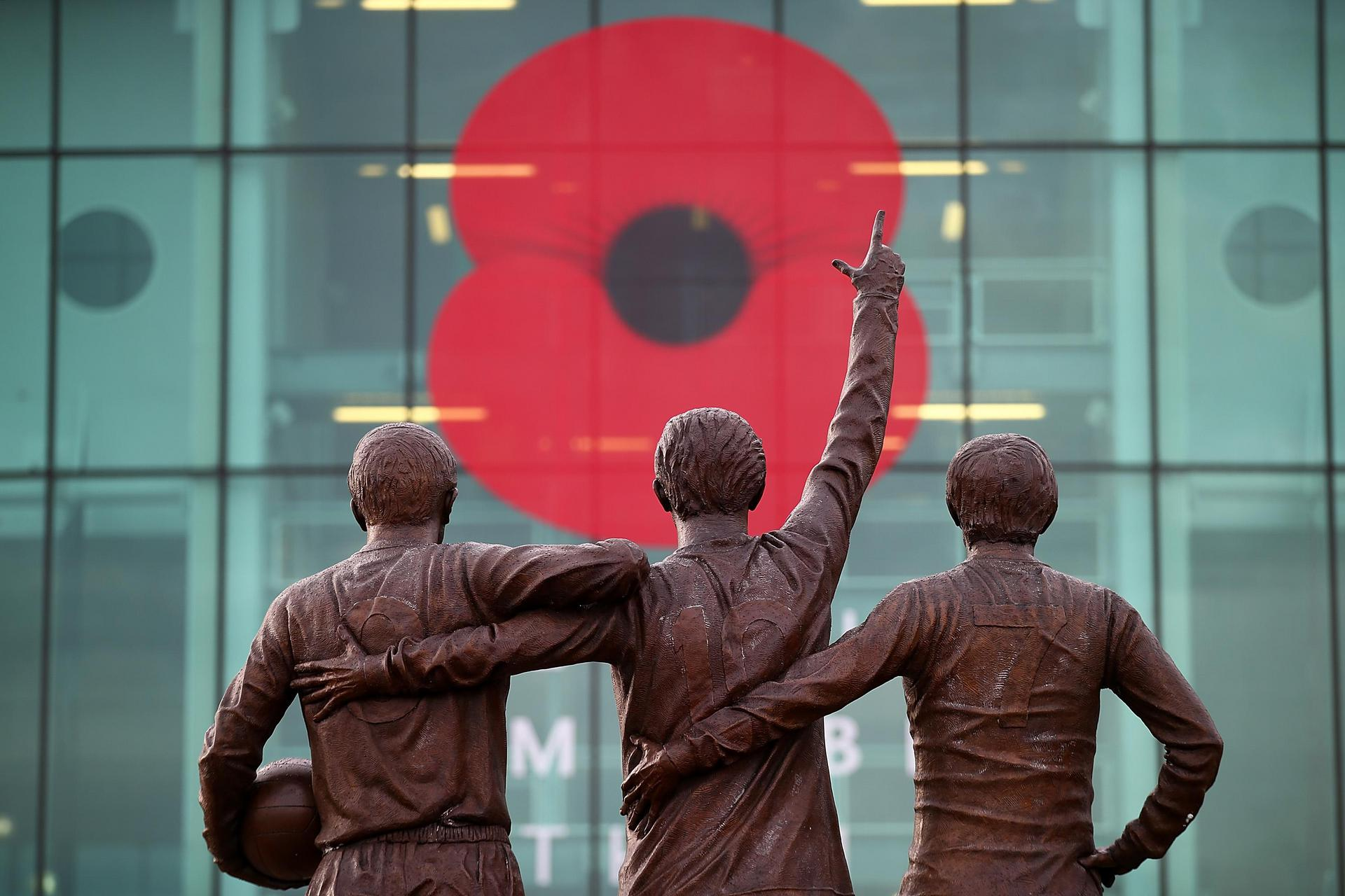 Poppy tribute for Remembrance on the East Stand window at Old Trafford