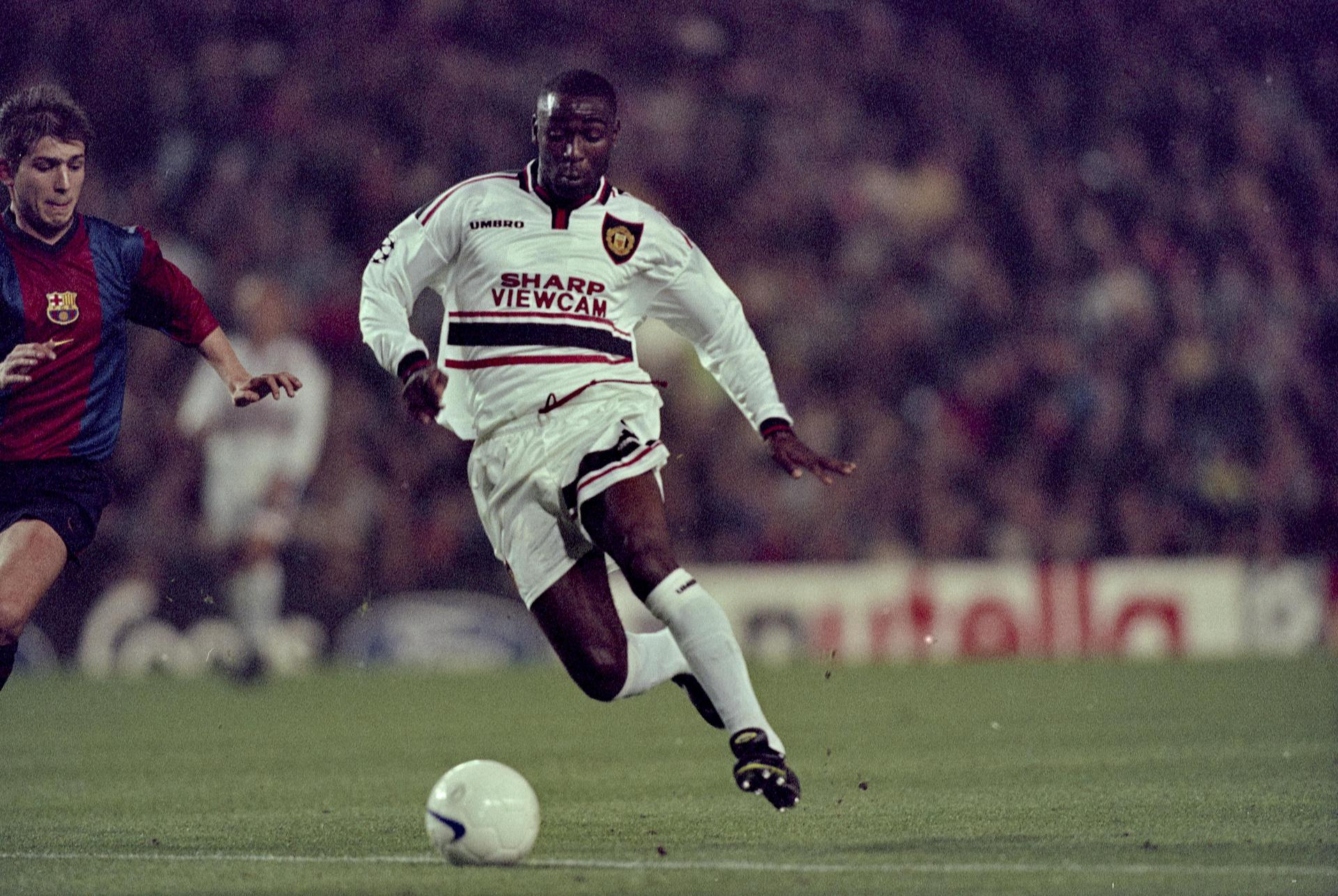 Andy Cole in action against Barcelona.