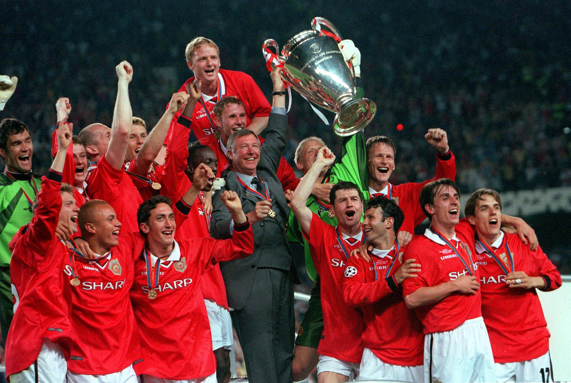 David May helps lead the United celebrations at the Nou Camp.