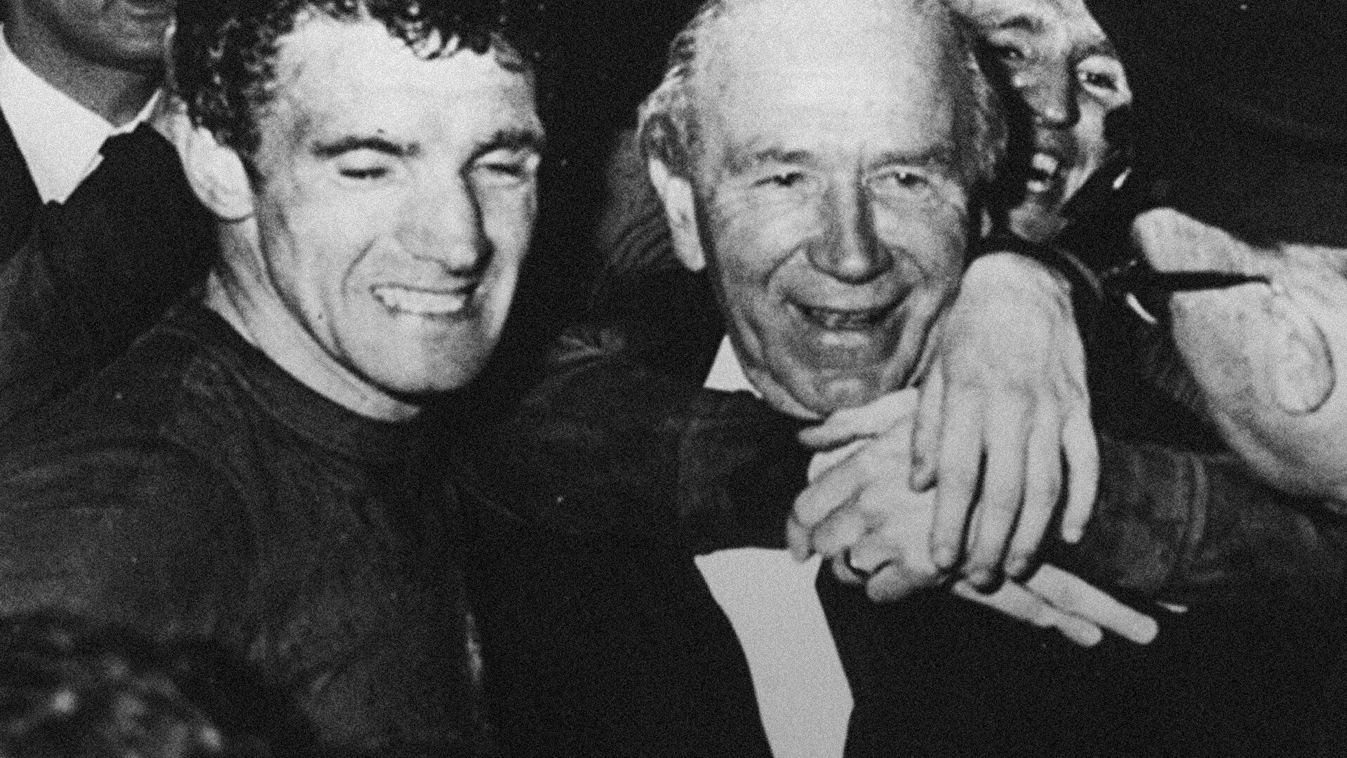 Matt Busby is hugged by Bill Foulkes and Pat Crerand after United's 1968 European Cup win