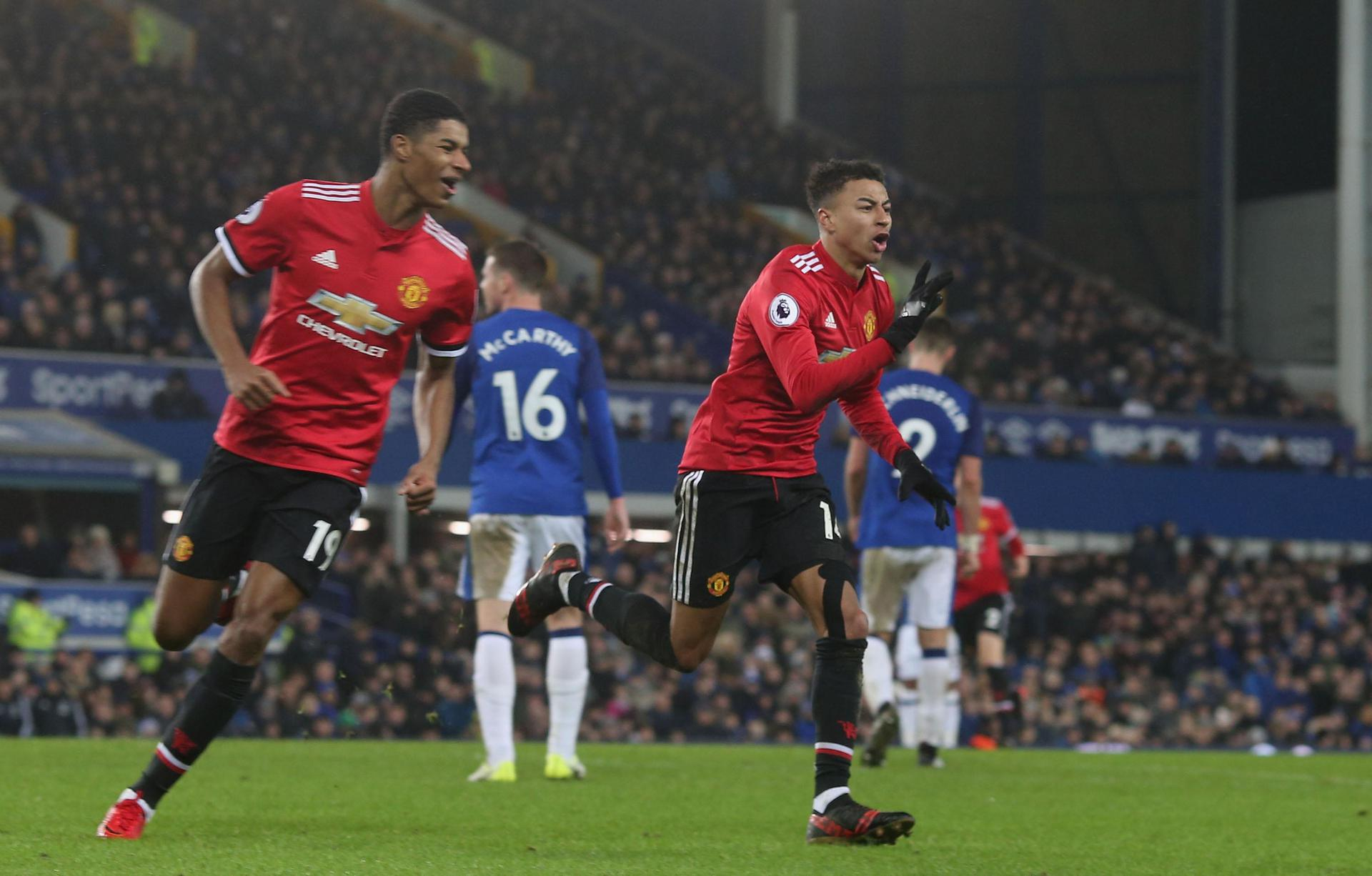 Jesse Lingard wheels away in delight after scoring United's second goal against Everton