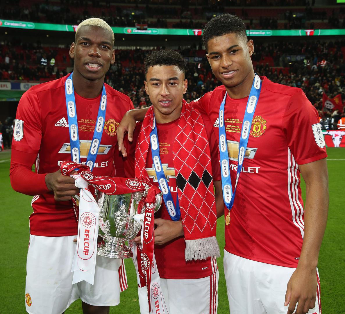 Paul Pogba, Jesse Lingard and Marcus Rashford with the League Cup in 2017.