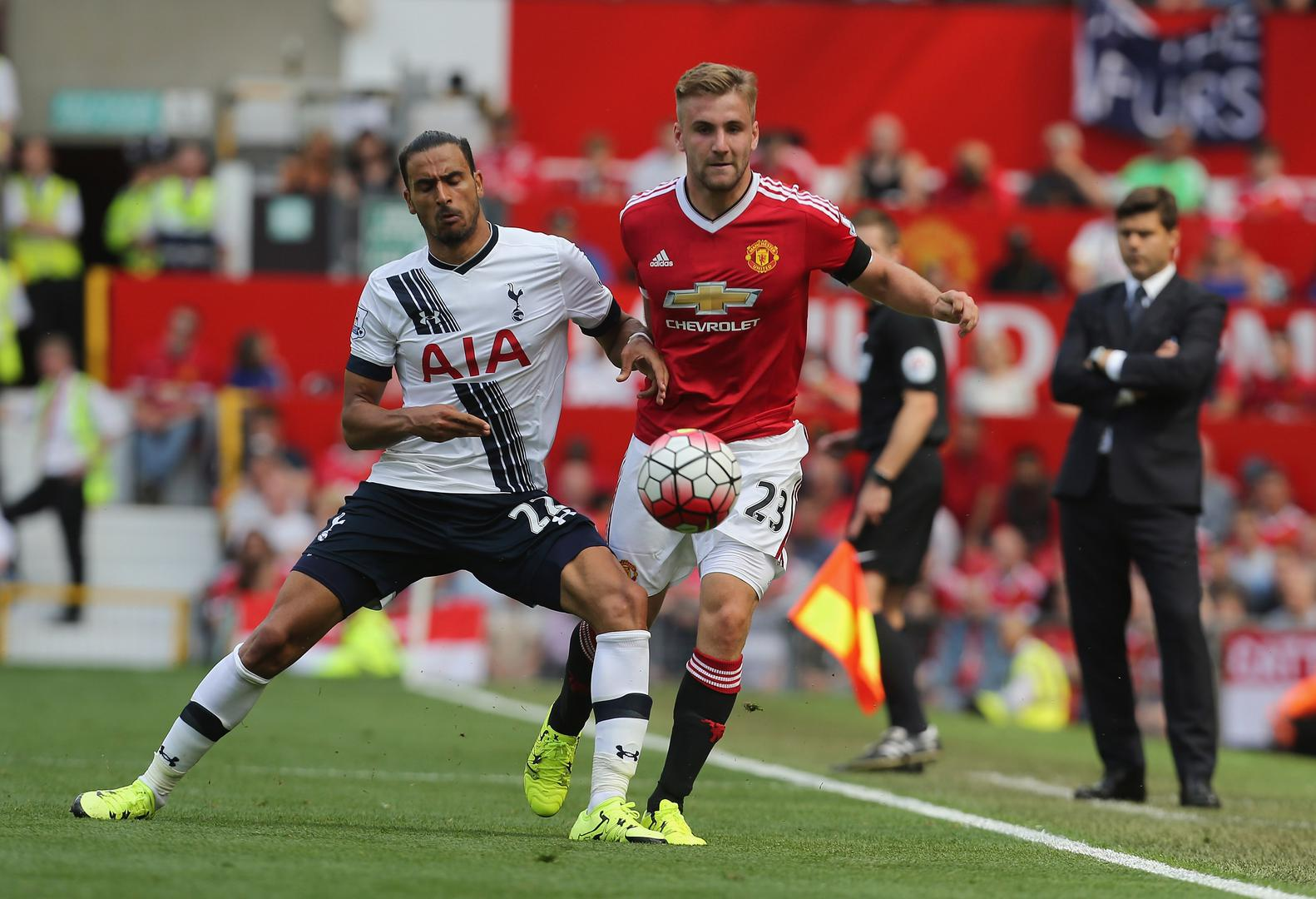 Luke Shaw and Nacer Chadli compete for the ball during Manchester United's opening-day fixture against Tottenham Hotspur in 2015.
