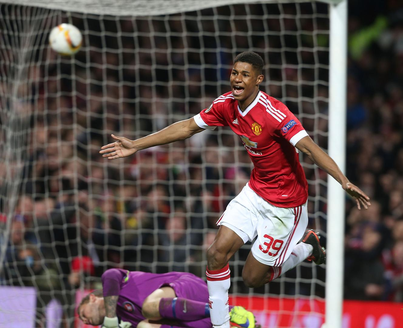 Marcus Rashford celebrates after scoring his first senior goal for Manchester United, against Fc Midtjylland