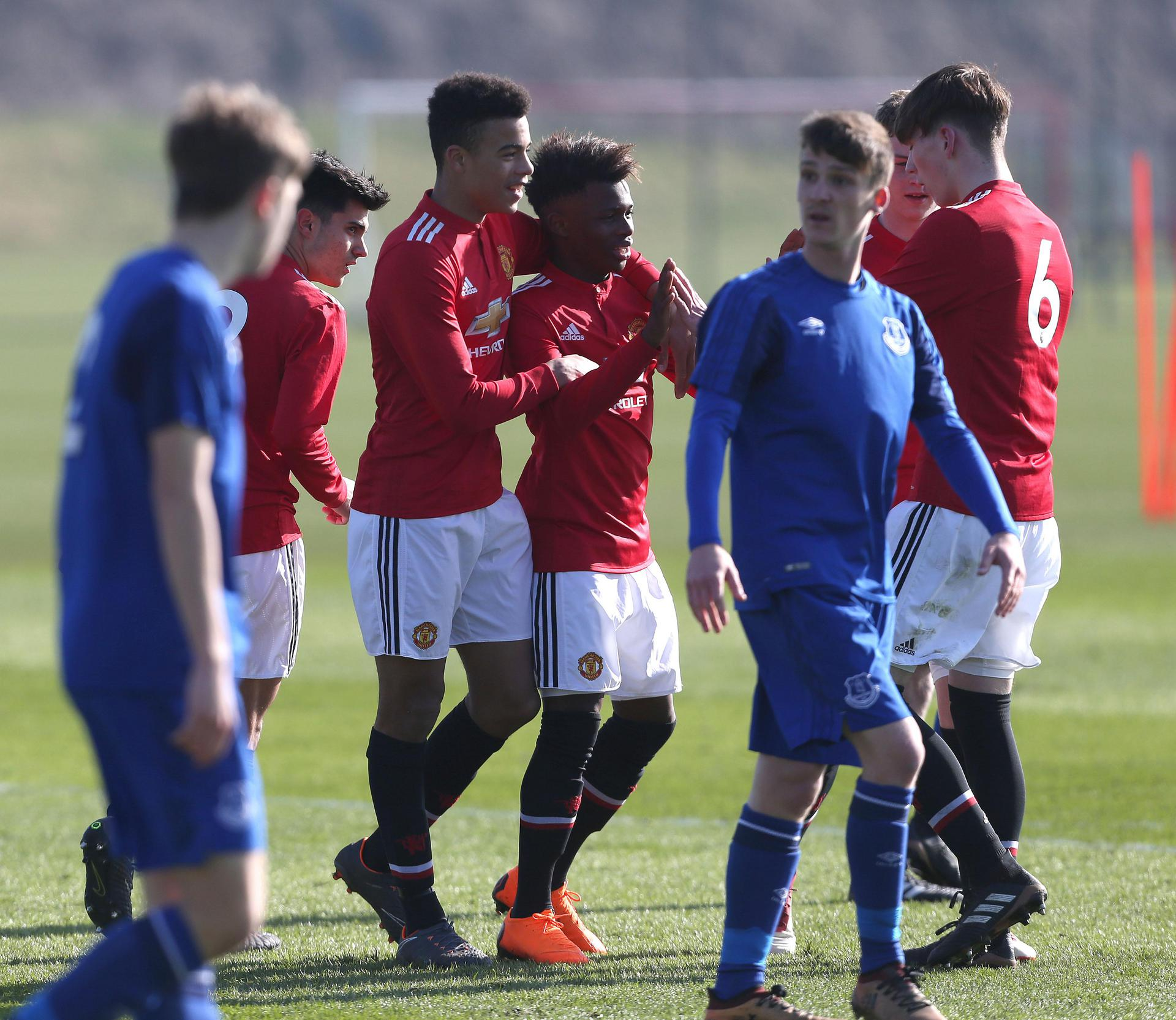 United Under-18s celebrate a goal against Everton in February 2018