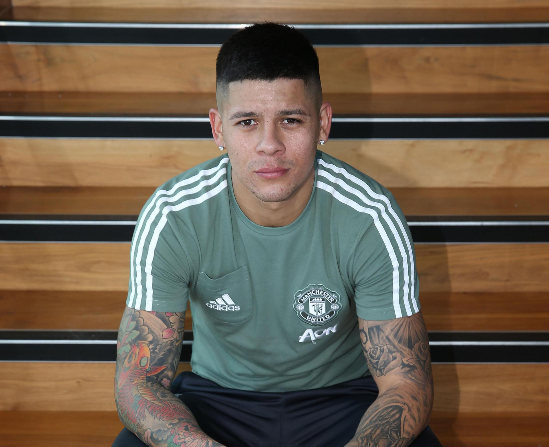Marcos Rojo posing in his training kit at the Aon Training Complex.